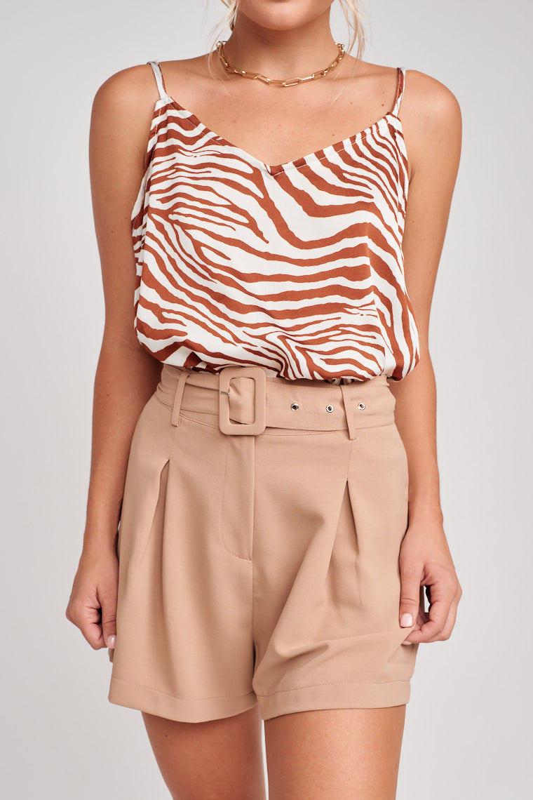 These belted shorts are a relaxed fit with inverted pleats and side pockets. Style it with bodysuits, tees, or crop tops to make it an easy peasy look.