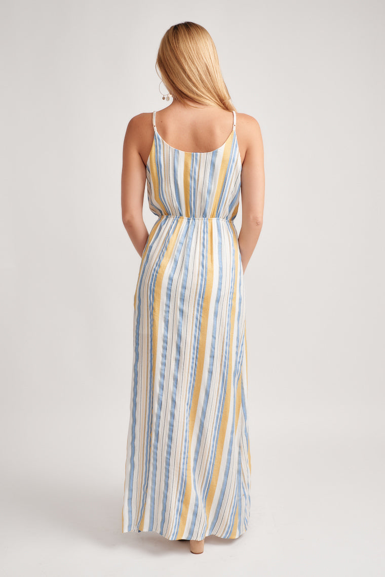 Blue, yellow and white stripes decorate this maxi dress. Adjustable skinny straps offer a custom fit. The cinched waistline carries into a straight cut maxi.