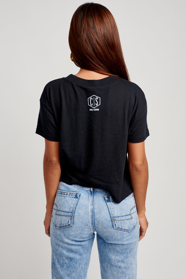 "This oversized and comfy black tee has ""I Wanna See You Touch It Down"" in white text across the chest. Pair with denim shorts and sneakers for a look."