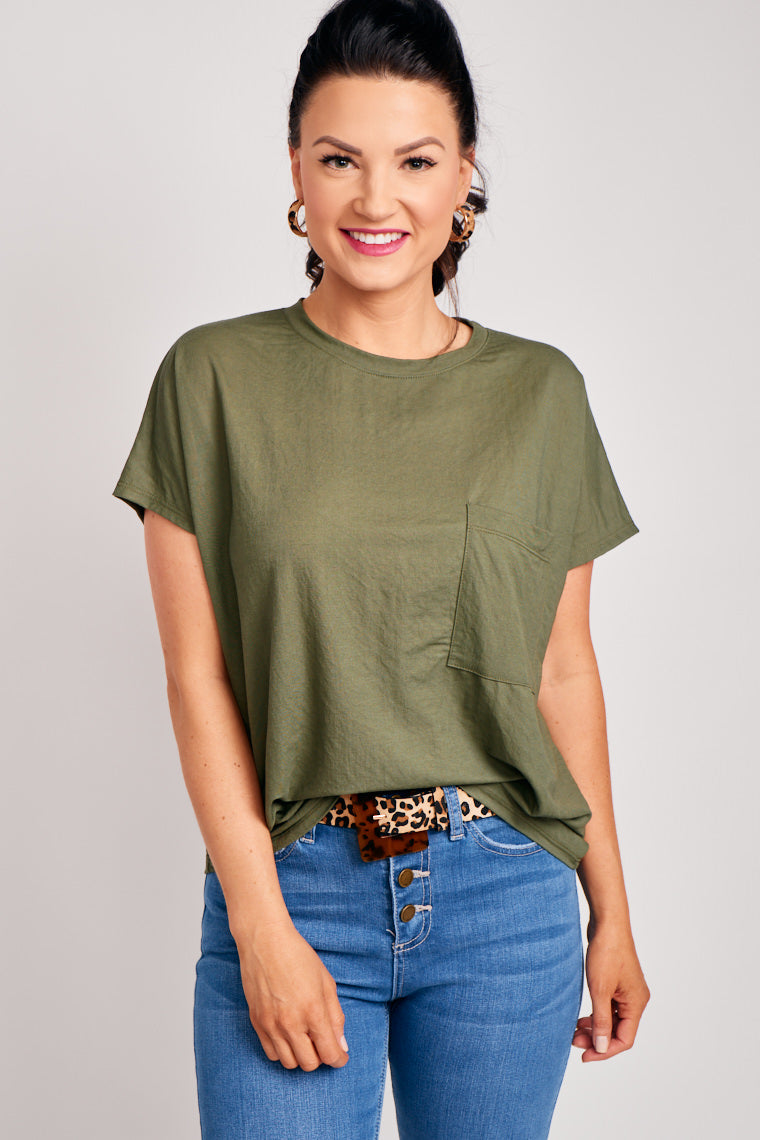 This lightweight shirt has short sleeves that attach to a banded u-neckline and lead to an oversized and relaxed bodice silhouette with a front pocket at the chest.