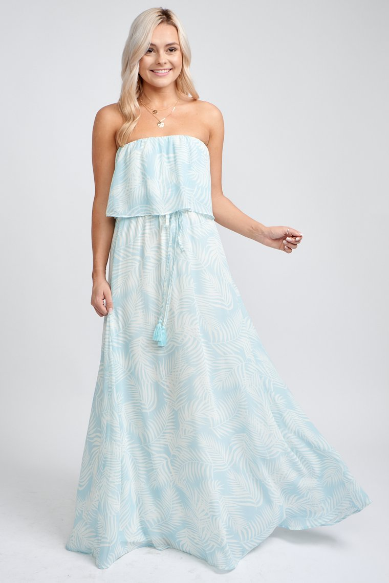 Lightweight and strapless maxi. It has an elastic hem that leads to a flounce bodice over an elastic waistband and flows down to a long maxi skirt silhouette.