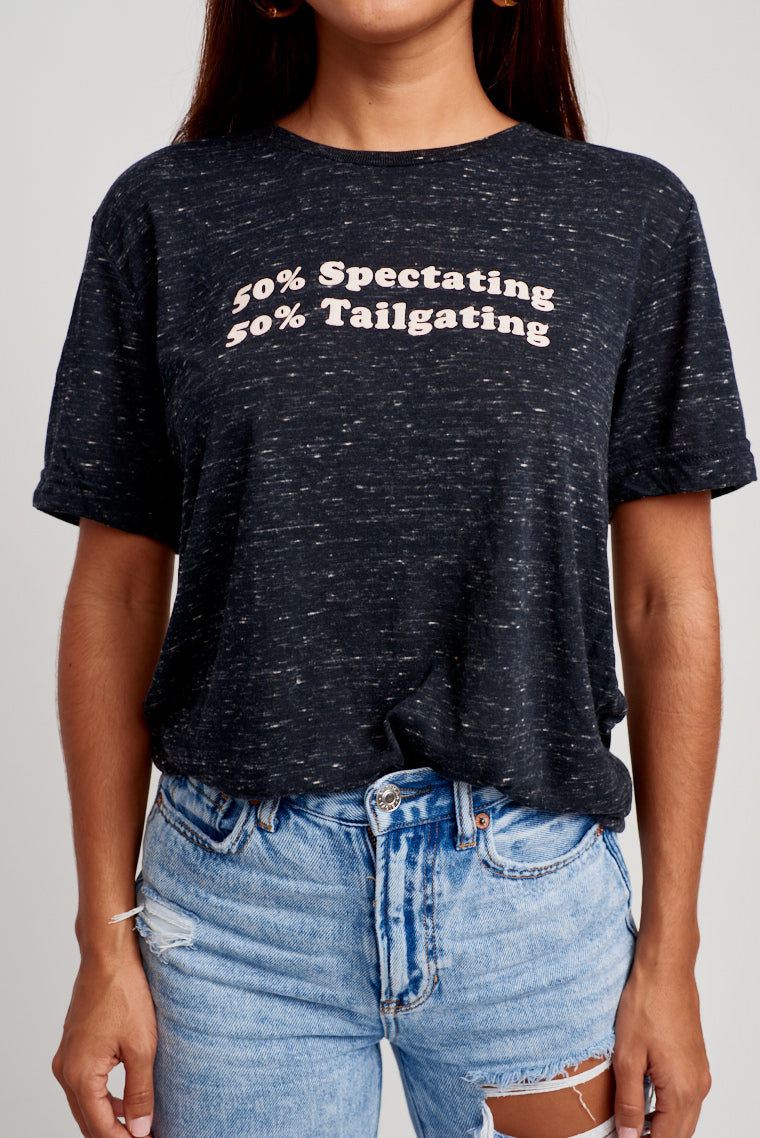"This comfy and oversized black heather top has ""50% Spectating 50% Tailgating"" in white text on the chest. Pair withThis comfy and oversized black heather top has ""50% Spectating 50% Tailgating"" in white text on the chest. Pair with denim shorts and your game day buttons.This comfy and oversized black heather top has ""50% Spectating 50% Tailgating"" in white text on the chest. Pair with denim shorts and your game day buttons. denim shorts and your game day buttons."