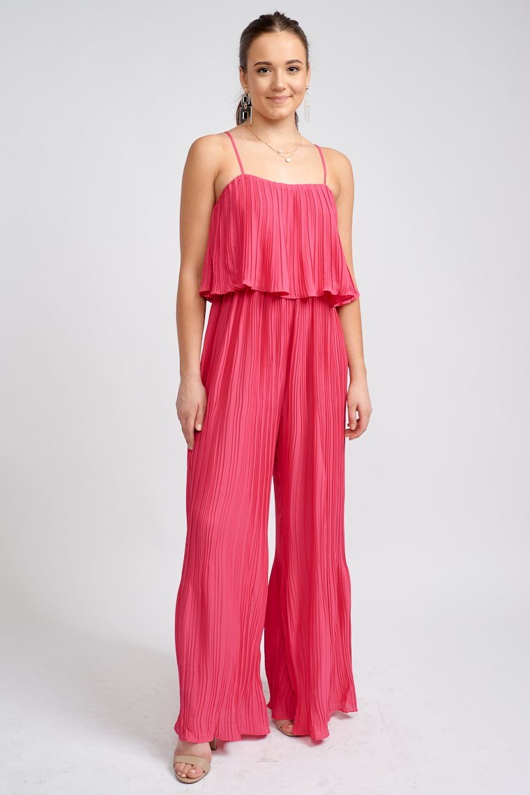 Thin adjustable straps attach to a straight neckline on a flounce bodice with an elasticized waistline and lead down to flowy wide pant leg.
