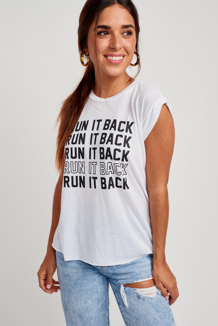 "This comfy white tee has short sleeves and ""Run It Back"" in black text repeatedly down the chest. Pair this with a simple solid skort and sandals for a sassy game day outfit!"