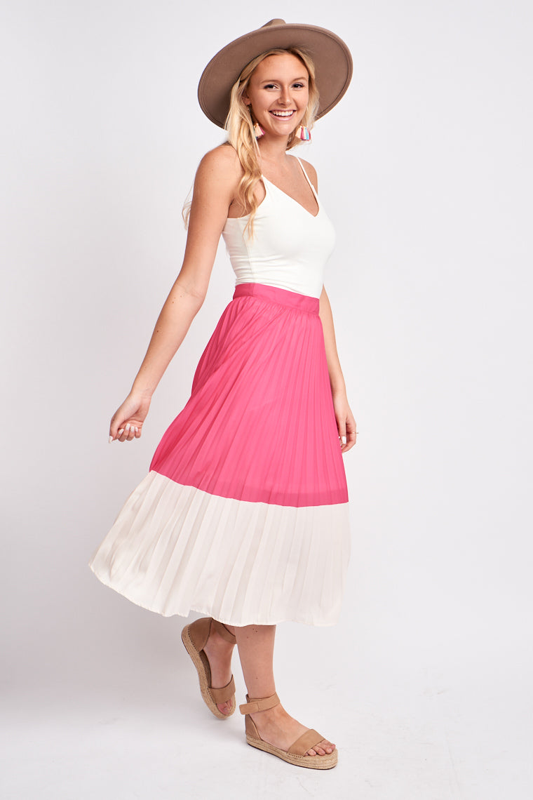 A bright pink sits atop white fabric of this darling midi skirt. This skirt has a fitted banded waist and leads to a pleated a-line silhouette that meets at the mid-calf.