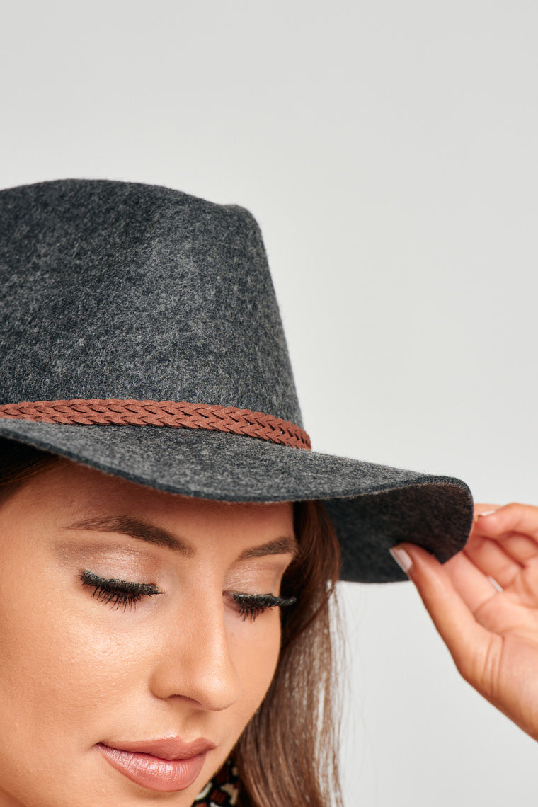 This medium brim woven Panama hat has a dual braided suede cord wraps around the crown of the hat.