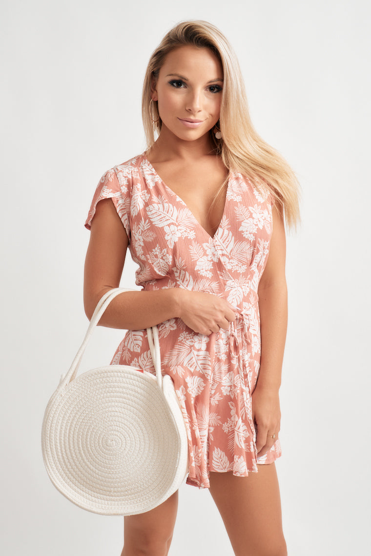 Marvelous mauve shade with white floral shapes this tulip sleeve, surplice bodice flowing into a fitted waist with a belt feature, and flowy and flirty shorts.