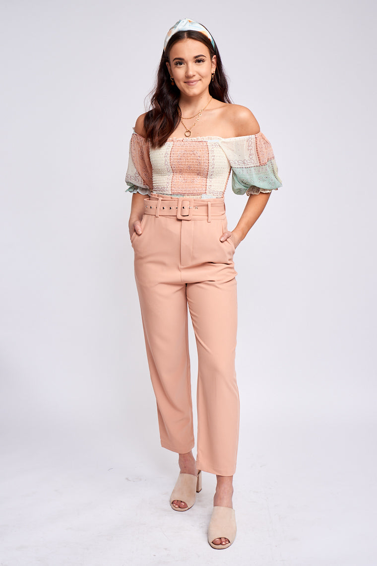 These high-rise pants have a fitted and belt-looped waistline with a zipper fly that leads to a hip-hugging silhouette with side cut pockets then leads to straight pant legs.