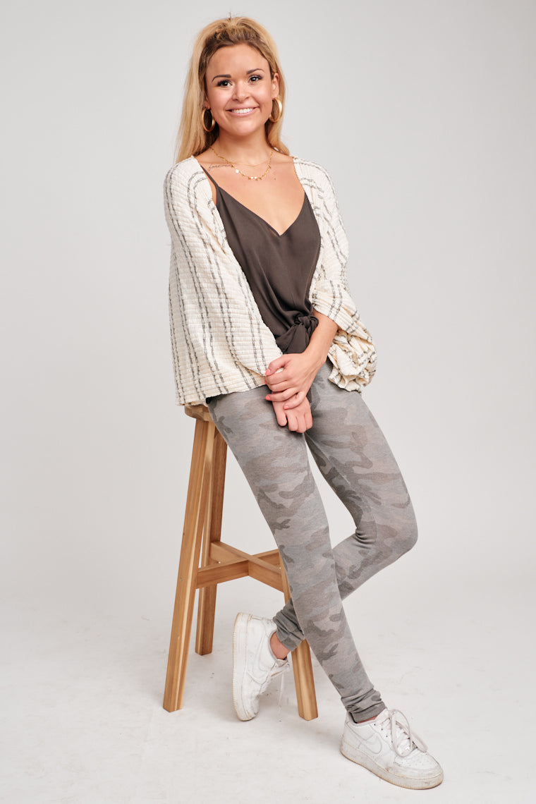 Large sleeves effortlessly sit on the shoulders and fall down to a comfortable and oversized silhouette as its drapes high in the front and longer on the back.