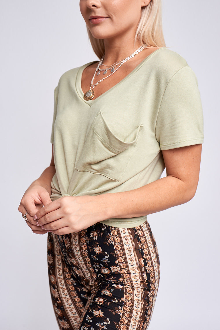 This t-shirt is soft and comfortable for everyday wear! Short sleeves attach to a banded v-neckline on an oversized and relaxed bodice silhouette with a front pocket at the chest.