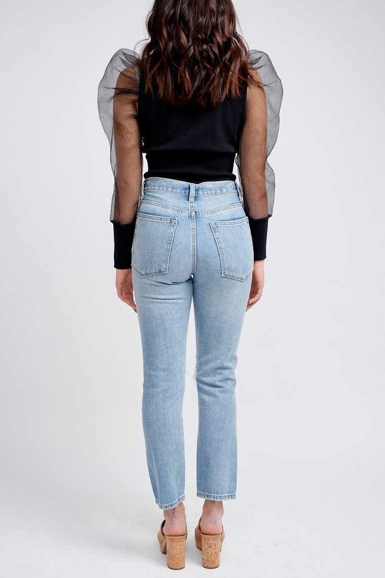 Distressed jeans have a traditional 5-pocket structure with a high button waistband that fits comfortably in a boyfriend-style and has distress details down the pant legs.