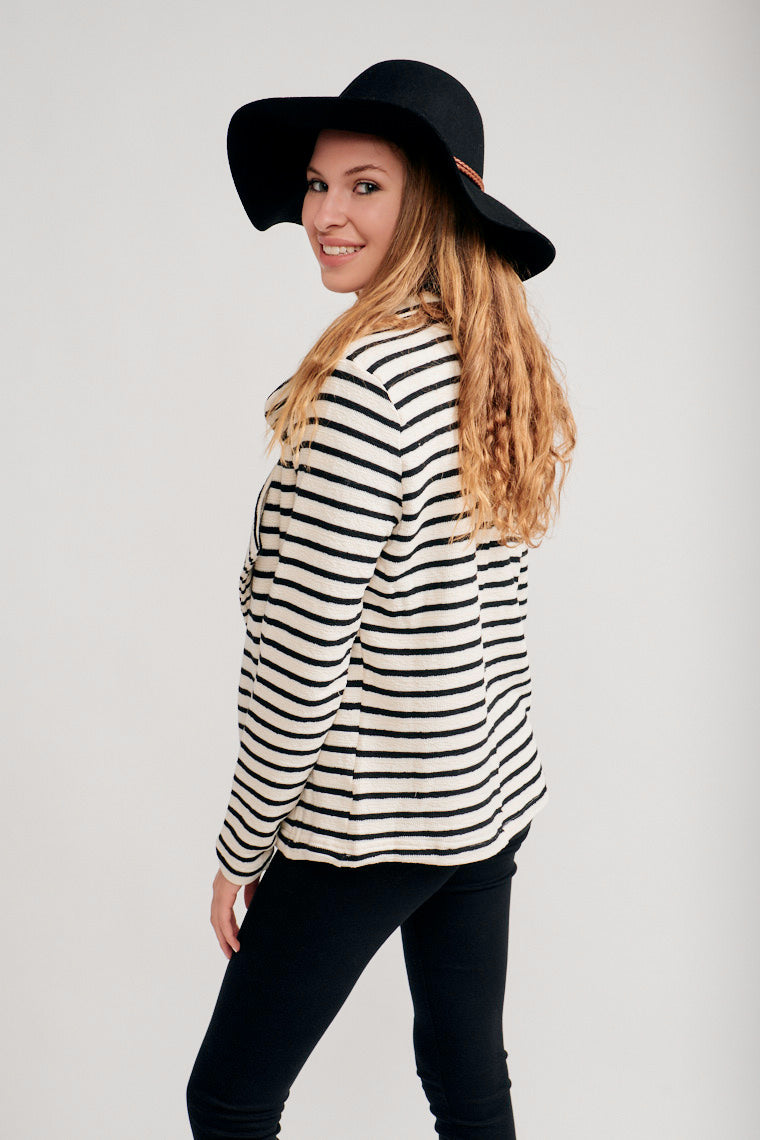 This striped jacket has long fitted sleeves that attach to a classic collared neckline and go into an open-front bodice with pockets at the side and meets at the hips.