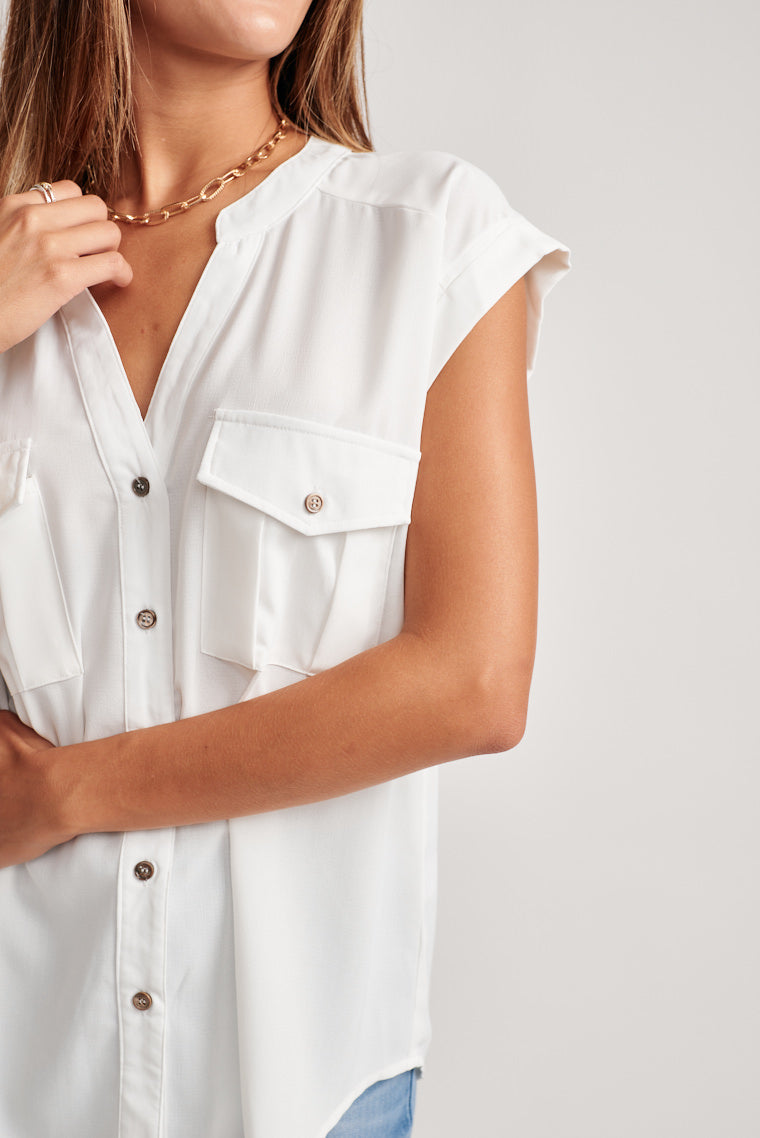 This lightweight short sleeve blouse will keep you cool and comfortable. A collarless v-neckline offers a half, button-down bodice with two front pockets.