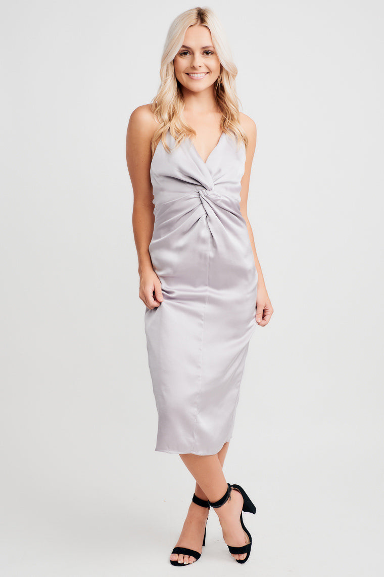 This silver dress has skinny adjustable straps that cross at the back and lead into a v-neckline with twist detail, with a comfortable darted skirt silhouette.