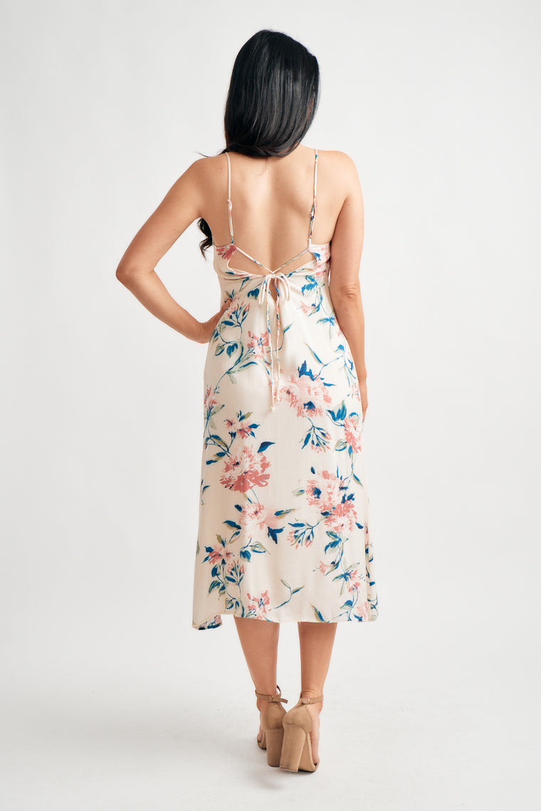 Pink and blue florals are blooming beauties on this v-neckline supported by skinny straps tying at the back with a shift silhouette finishing at a tea-length.