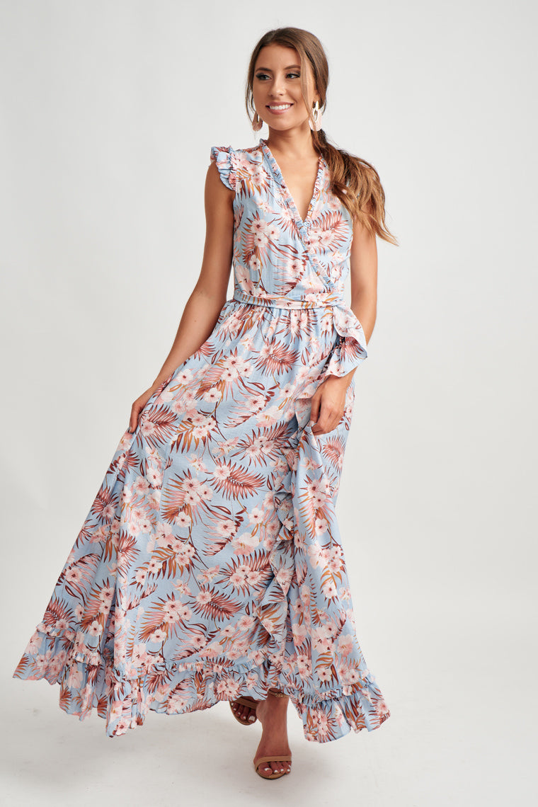 This floral maxi dress features cap flutter sleeves with a ruffle, surplice bodice wrapping to the side maxi skirt and cascading ruffle down the flowy maxi skirt.