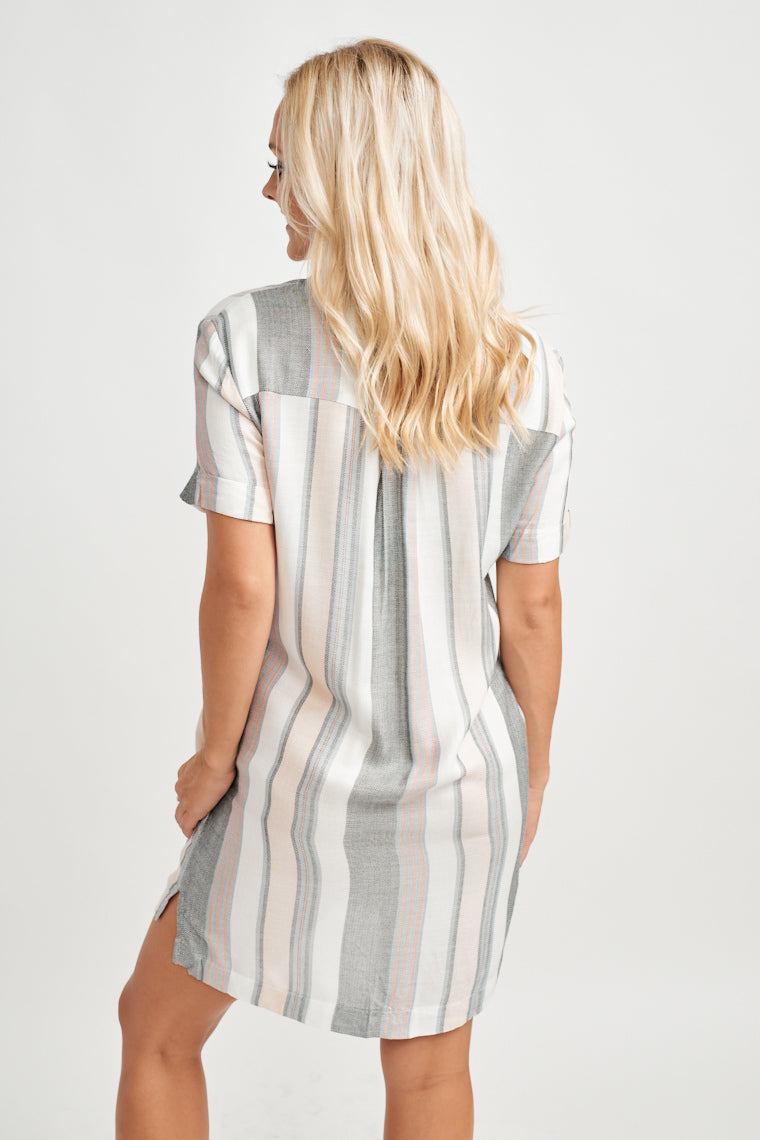 This lightweight, multi-striped shift dress is simple to throw on. It has a collared neckline and a button-down, shift silhouette with two side-slit pockets.