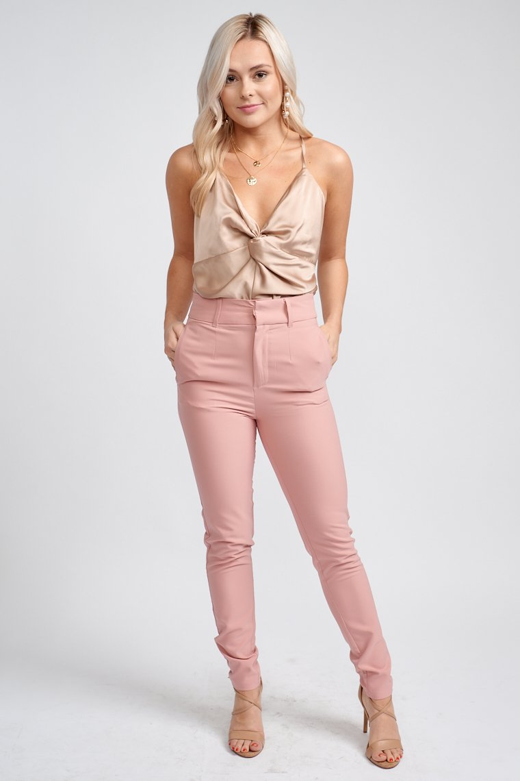 High-waisted fit with belt loops that lead a zipper with hook clasps to hidden side pockets and then taper down to straight and skinny pant legs.