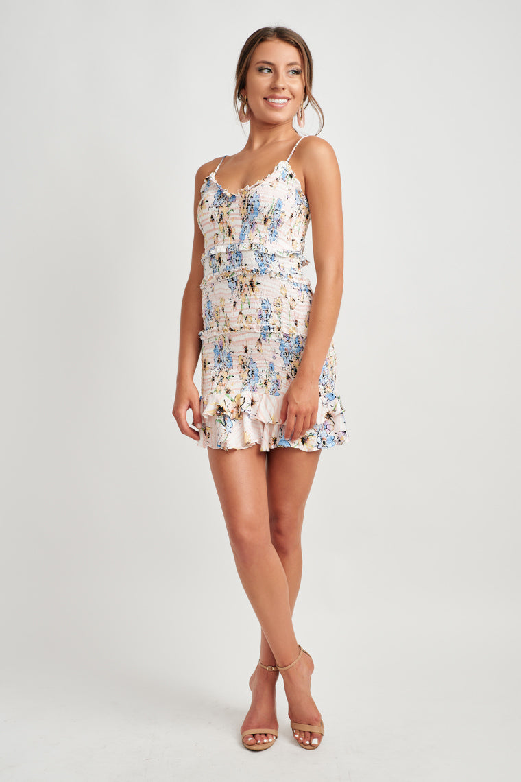 9f0e384fe1b4 Beautiful florals decorate this ivory bodycon dress offering adjustable  skinny straps on a ruffled, v