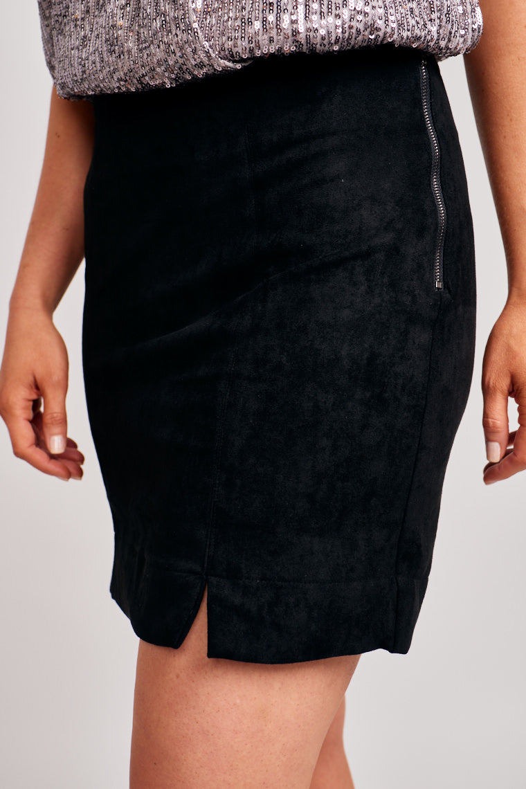 This skirt has a banded waistline that leads to a fitted and paneled skirt. This skirt features a zipper with hook and eye closures at the side.