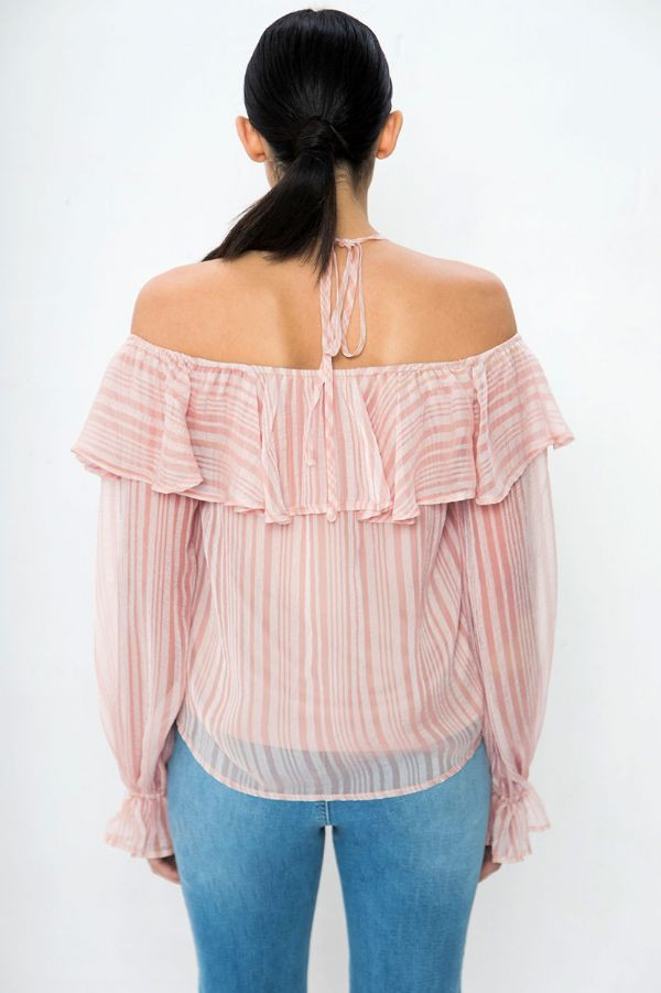 It has long elastic ruffle cuffed sleeves that attach to an off-the-shoulder and v-neckline with a ruffled hem before it goes down into a darted and relaxed fit bodice.