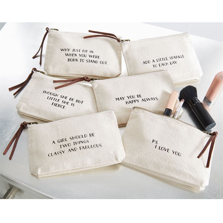 Heavy canvas multi-use pouches feature leather zipper pulls and black printed sentiments.