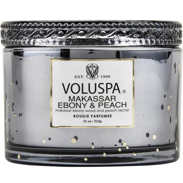 Notes of Solid Black Ebony Wood, Ripe Peaches & Apple Blossom.From the gold plating, to the reflective metallic container, this candle exudes class from the inside out.