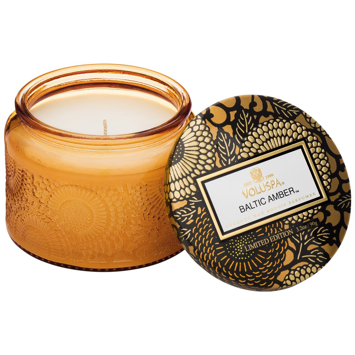 Notes of Amber Resin, Sandalwood & Vanilla Orchid. This embossed candle features a metallic lid, making it perfect for travel and smaller spaces.