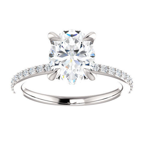 14k wg diamond ring with 9x7mm Forever One Oval Moissanite