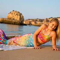 Fin Fun at the beach with a swimmable Rainbow Mermaid Tail and Monofin