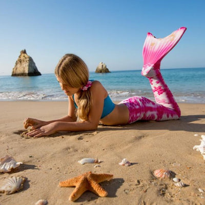 Fun at the beach with the Chelsea Pink Rose Mermaid Tail