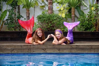 Fun with Sunset Splash and Purple Surf Mermaid tails