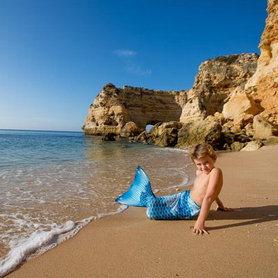 Boy-mermaid-at the beach-with-planet-mermaid