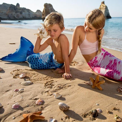 Pink and Blue mermaids at the beach