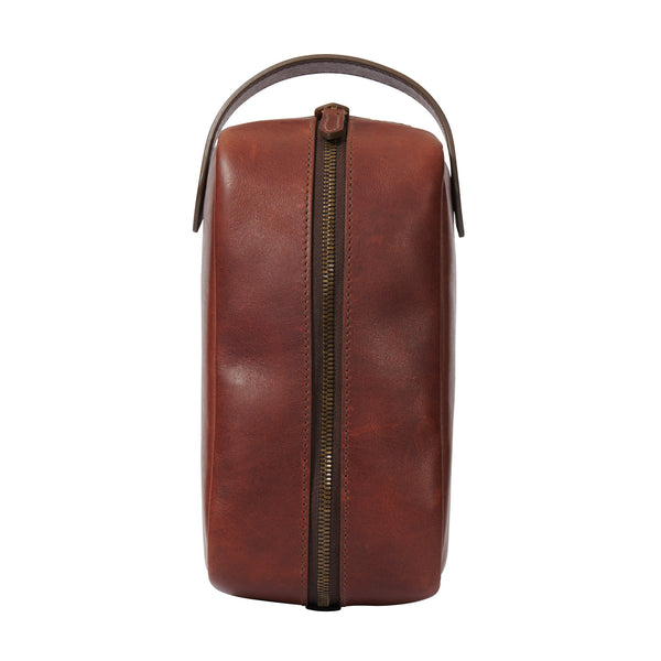 upright view of full grain leather toiletry bag in vintage brown