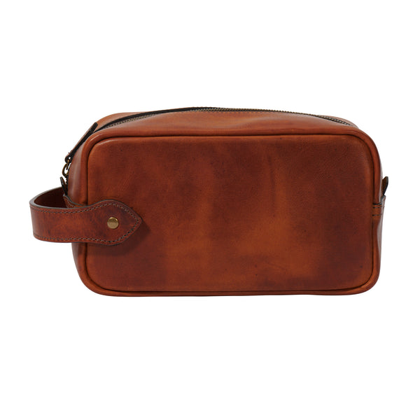 full grain leather Dopp kit bag in saddle tan color by Jackson Wayne