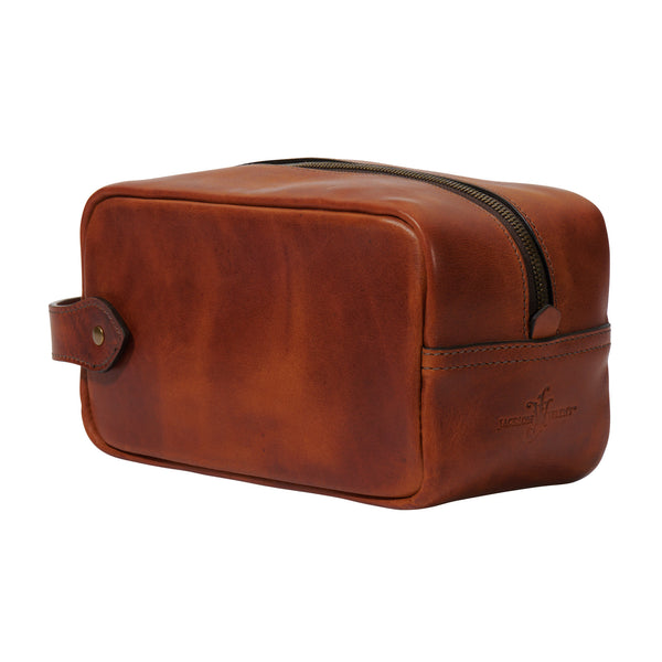 full grain leather toiletry bag by Jackson Wayne in saddle tan color
