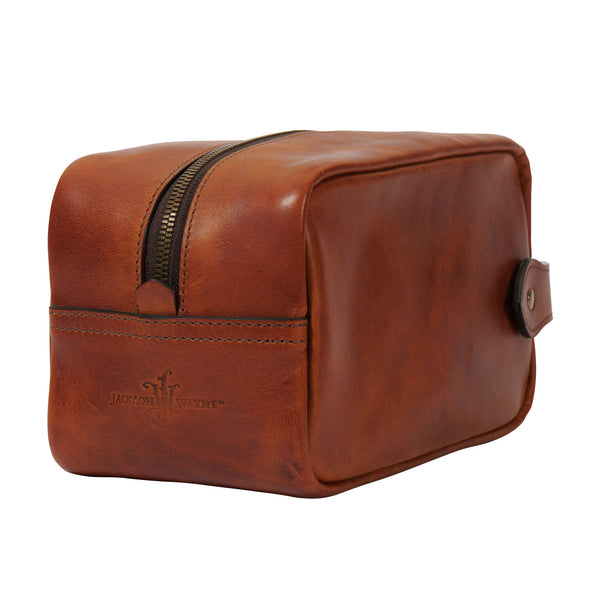 back angle of saddle tan full grain leather Dopp kit