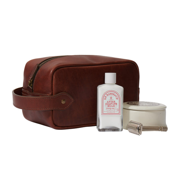vintage brown men's leather Dopp kit with shaving accessories