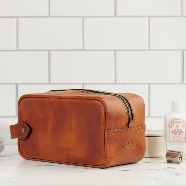 Jackson Wayne full grain leather dopp kit in saddle tan in bathroom with shaving accessories