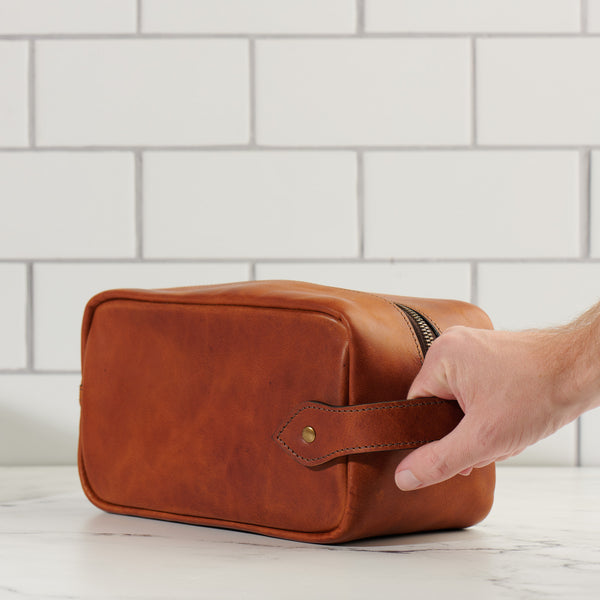 full grain leather Dopp kit grab handle in saddle tan color