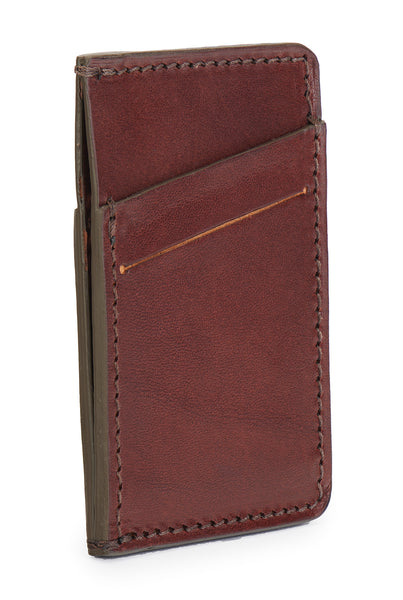 vegetable tanned bridle leather minimalist wallet angle empty pictured in vintage brown