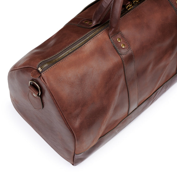 top detail of vintage brown vegetable tanned leather duffel bag weekender