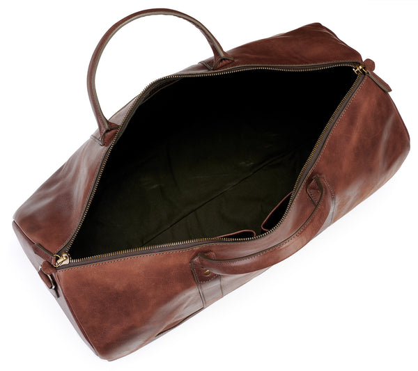 inside open of Big Sur Duffle bag in vintage brown color with water repellent army canvas lining in Pine Green and vintage brown leather