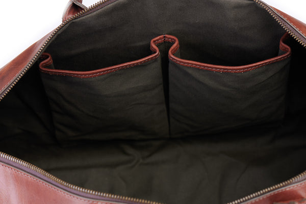 inside slip pockets on big sur duffle bag in vintage brown green lining