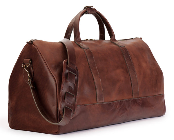 angle view of full grain leather duffel bag in vintage brown color