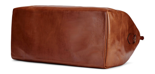 bottom of full grain vegetable tanned leather duffel in saddle tan