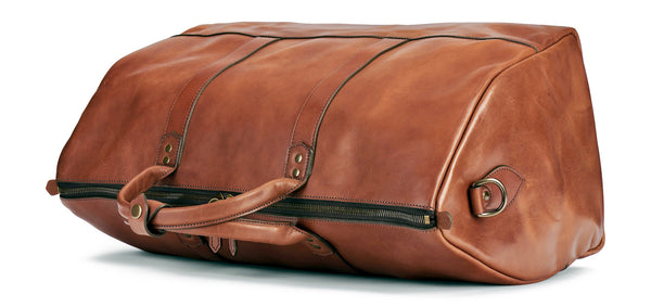 top of full grain leather duffle bag in saddle tan
