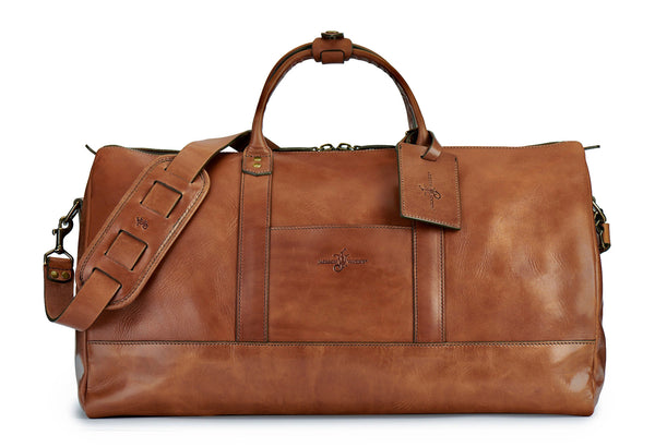 saddle tan full grain leather weekender bag with luggage tag in saddle tan