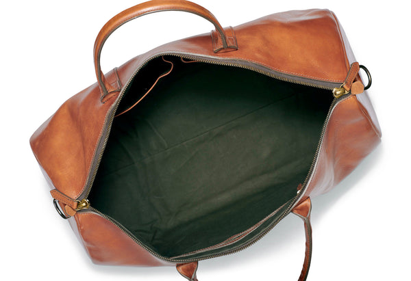 inside water repellent army green canvas of full grain leather duffle by Jackson Wayne